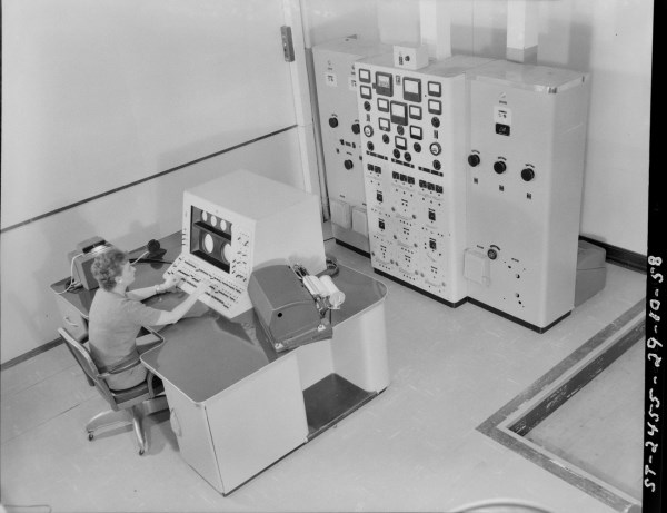 This photo shows both the main console and the power control panel. You will note from the right side of the photo that the floor is raised to allow wiring to be run between the various units. Photo courtesy of the NRC Archives.