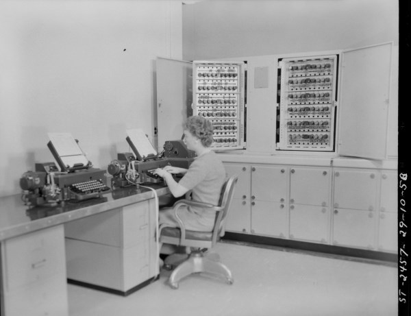 This area was to the immediate left of the main entrance to the computer room and was where users would input their data and program instructions that were punched out on paper tape. The open doors are for show only as they would have been closed when the machine was operating. Photo courtesy of the NRC Archives.